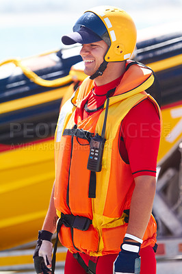 Buy stock photo A sea rescue worker and his speedboat