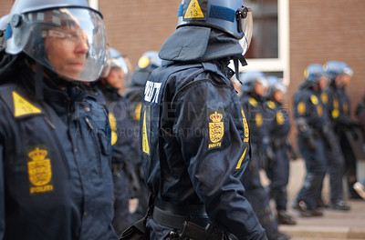 Buy stock photo Shot of a line of riot police