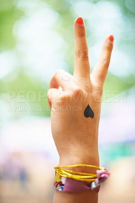 Buy stock photo A young woman with a heart tattoo on her hand
