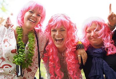 Buy stock photo Three friends having fun at a festival