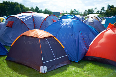 Buy stock photo A group of tents pitched together outside at a festival