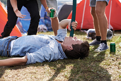 Buy stock photo Shot of a man drinking beer at a festival through a funnel