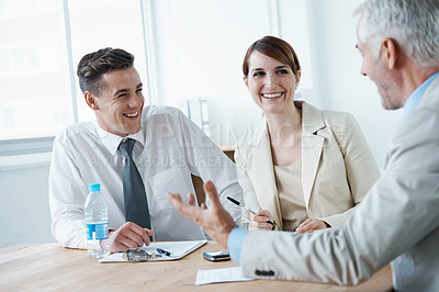 Buy stock photo Shot of business people in a business meeting