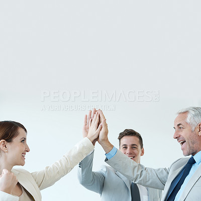 Buy stock photo Business people celebrating another successful deal with a high-five