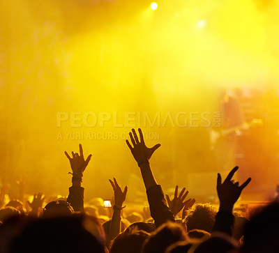 Buy stock photo Shot of fans enjoying an outdoor music festival