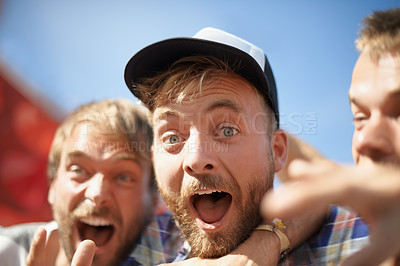 Buy stock photo Portrait of young male friends enjoying themselves at an outdoor festival