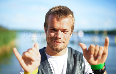 Buy stock photo Head and shoulders shot of a young man having a good time at an outdoor festival