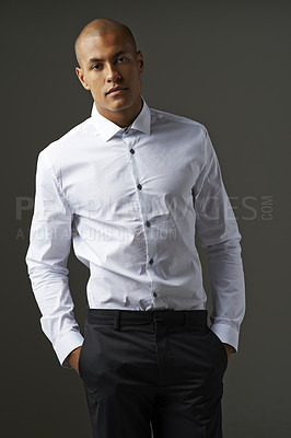 Buy stock photo Studio portrait of a well-dressed young man