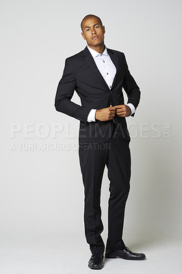 Buy stock photo Full length studio portrait of a young man in a suit against a gray bakground