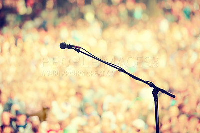 Buy stock photo A microphone on a stand on an empty stage with the audience in the background