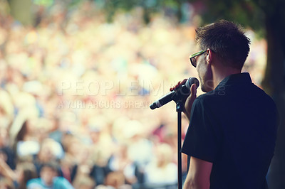Buy stock photo A singer performing on stage at a music concert