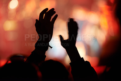 Buy stock photo Rear view shot of the audience during a live music concert
