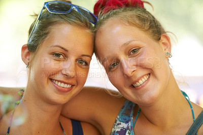 Buy stock photo Portrait of two happy female friends at an outdoor festival