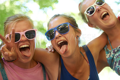Buy stock photo Cropped portrait of a group of girlfriends having fun at an outdoor festival