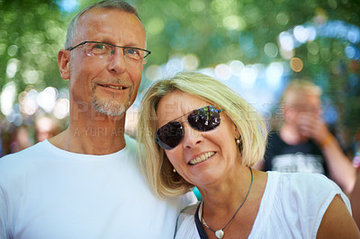 Buy stock photo Portrait of an affectionate mature couple at an outdoor festival
