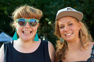 Buy stock photo Shot of two young women at an outdoor festival
