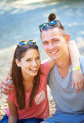 Buy stock photo Two young people smiling happily as they sit outside