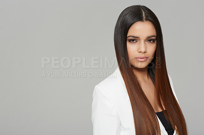 Buy stock photo Studio shot of a young brunette woman looking at the camera