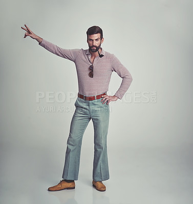 Buy stock photo Studio shot of a man in 70's style clothing