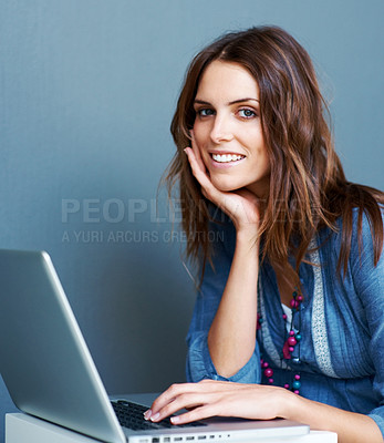 Buy stock photo Happy young female working on laptop