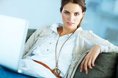 Buy stock photo Confident young woman sitting with a laptop