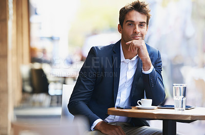 Buy stock photo Portrait of a young businessman sitting at an outdoor cafe