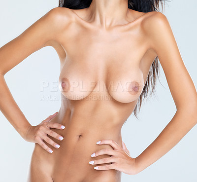 Buy stock photo Cropped shot of the midriff of a nude female body