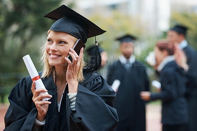 Buy stock photo An attractive young woman talking on a cellphone while holding her degree