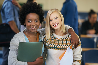 Buy stock photo Portrait of two university students standing together in a lecture hall