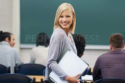 Buy stock photo A young female student standing in the classroom