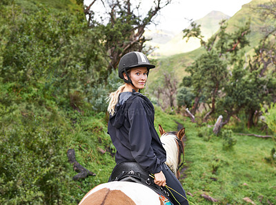 Buy stock photo An attractive young woman going for a horse ride on a mountain trail