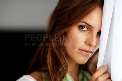 Buy stock photo Cute young woman looking confidently