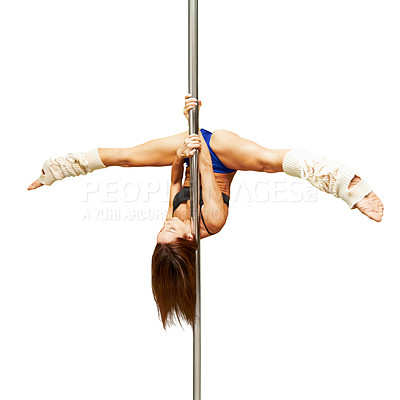 Buy stock photo Studio shot of a young woman hanging upside down on a pole against a white background