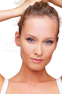 Buy stock photo Cropped head and shoulders shot of an attractive woman with her hands in her hair