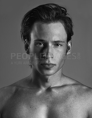 Buy stock photo Black and white studio shot of a handsome young man