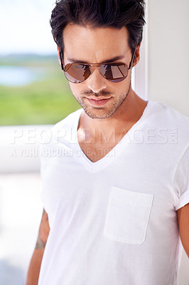 Buy stock photo Cropped view of a stylish young man wearing sunglasses