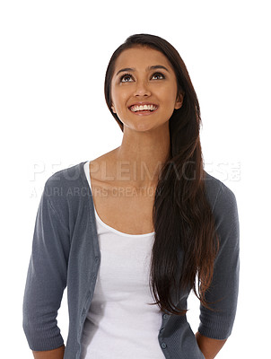 Buy stock photo A beautiful young ethnic woman smiling against a white background
