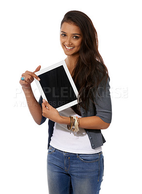 Buy stock photo A young ethnic woman presenting a digital tablet
