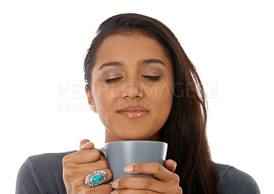 Buy stock photo A young ethnic woman holding a cup of coffee