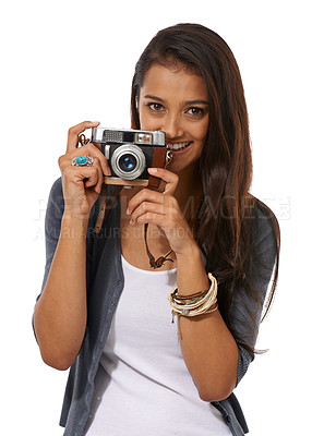 Buy stock photo Cropped portrait of a young photographer holding a camera while against a white background