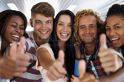 Buy stock photo Shot of young university students on the school campus