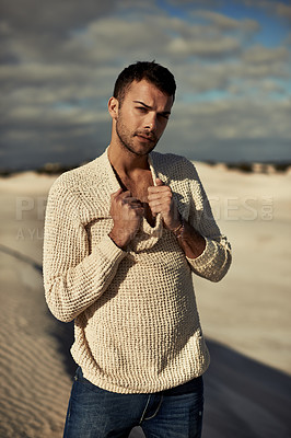 Buy stock photo A ruggedly handsome young man enjoying the beach
