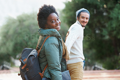Buy stock photo Shot of a college students between classes on the campus grounds