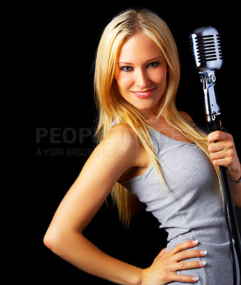 Buy stock photo Studio portrait of a beautiful singer isolated on black