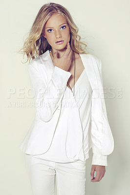 Buy stock photo Portrait of a beautiful young woman wearing a white suit posing in studio