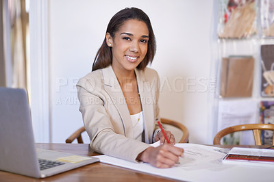 Buy stock photo Portrait of a young fashion designer working on some sketches