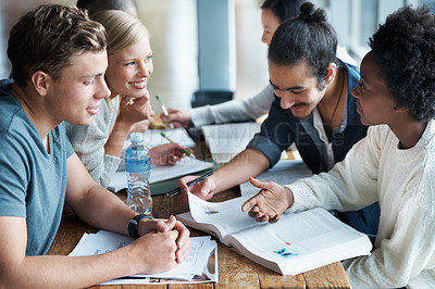 Buy stock photo A group of college students sitting together and studying
