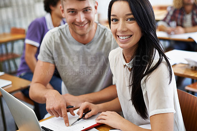 Buy stock photo A young male and female student studying in a classroom