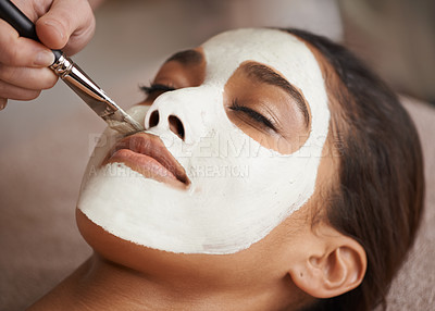 Buy stock photo A face mask being applied to a beautiful young woman at a beauty spa