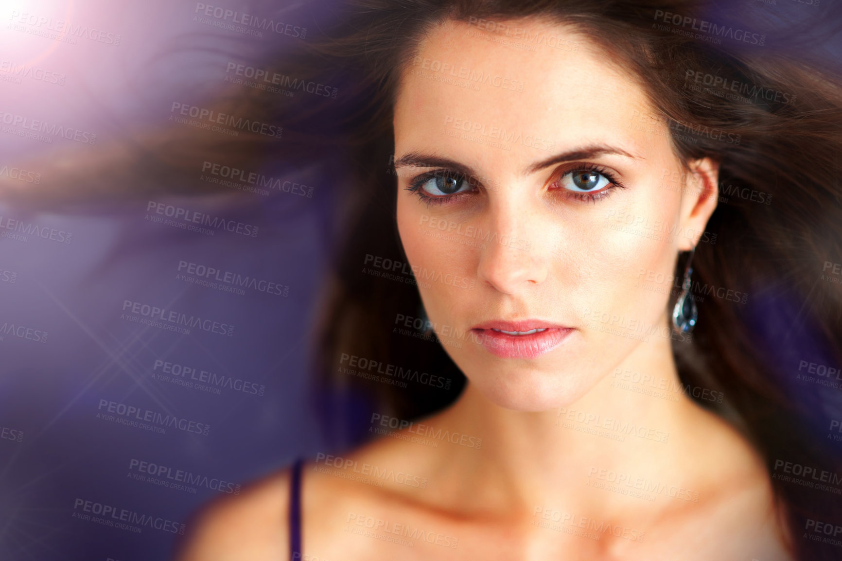 Buy stock photo Closeup portrait of an attractive young woman with a spotlight behind her